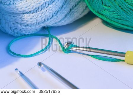 Crochet Hook Thread And A Fragment Of The Finished Pattern. Crochet With Wool Thread