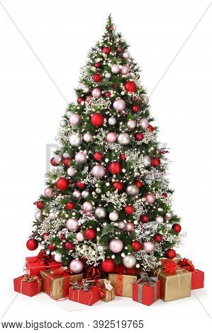 Decorated Christmas Tree Full Of Colored Balls, Decorations And Many Gift Wrapped  Packages Isolated