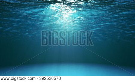 Dark Blue Ocean Surface Seen From Underwater. Abstract Fractal Waves Underwater And Rays Of Sunlight