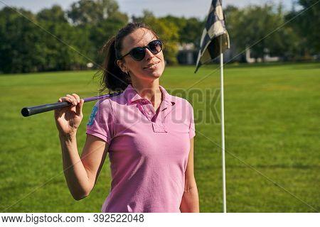 Joyous Female Golfer In Sunglasses Posing For The Camera
