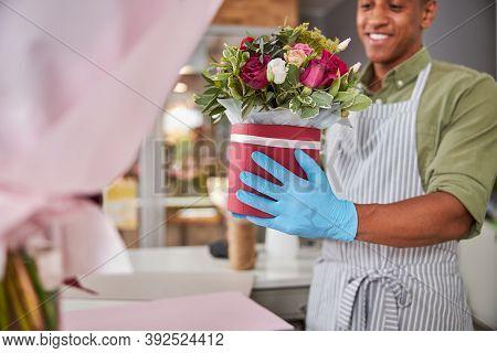 Joyous Afro-american Florist With A Flower Pot