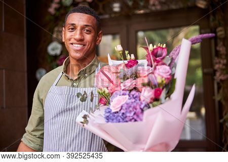Lively Florist Handing Over A Posy Of Flowers