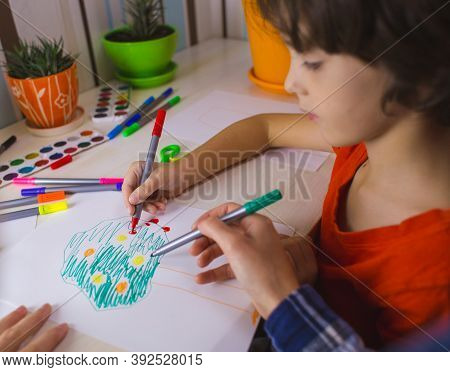 Art Lesson. Individual Lesson With A Teacher. A Child With A Teacher Is Engaged In Art Therapy