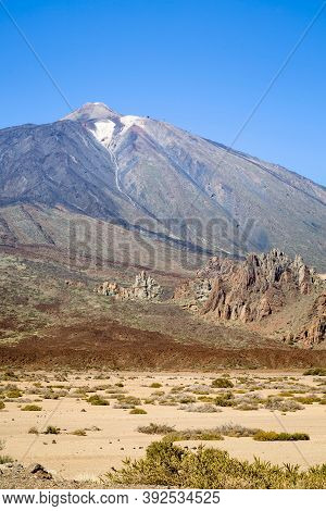 Los Roques De Garcia With Mount Teide In The Background. Volcanic Landscape In Teide National Park,