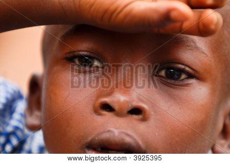 African Boy Shielding His Eyes