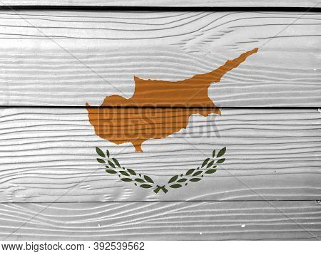 Flag Of Cyprus On Wooden Wall Background. Grunge Cyprus Flag Texture, An Outline Of The Country Of C