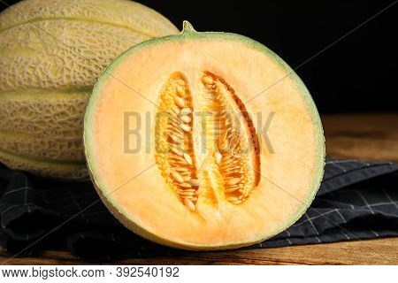 Tasty Fresh Melons On Wooden Table, Closeup