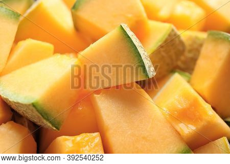 Pieces Of Tasty Ripe Melon As Background, Closeup