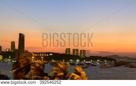 The Building And Skyscrapers In Twilight Time In Pattaya,thailand. Pattaya City Is Famous About Sea