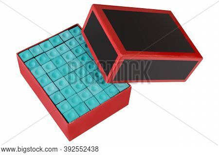 Cardboard Box With Turquoise Cue Crayons, Many Crayons, On A White Background