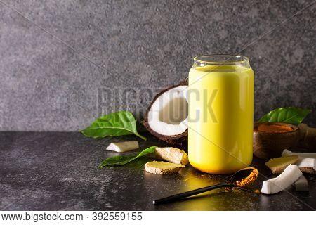 Healthy Drink. Ayurvedic Golden Coconut Milk With Curcuma Powder Ginger On A Stone Countertop. Copy