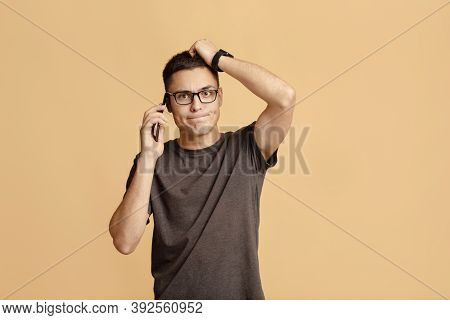 Heavy Question, Difficulties And Problems At Work Or Communication. Confused Young Man With Glasses