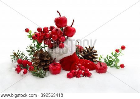 Christmas Decoration. Stocking With Red Berries And Apples, Twigs Christmas Tree, Cones Pine On Snow