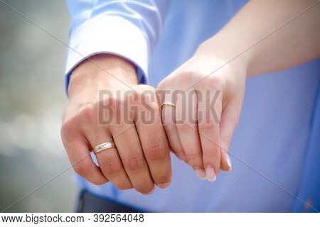 Hands Of Married Man And Woman With Rings Close Up
