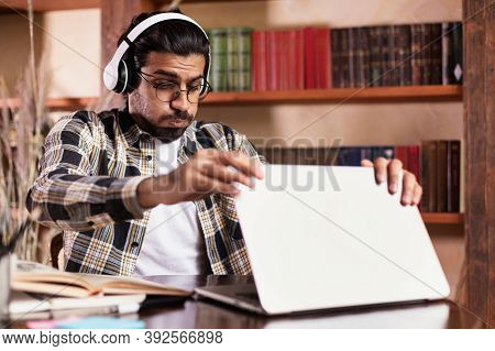 E-teaching And E-learning Problems. Tired Indian Teacher Shutting Laptop Computer After Distant Less