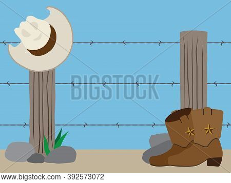 A Western Barbed Wire Fence With Cowboy Hat And Boots