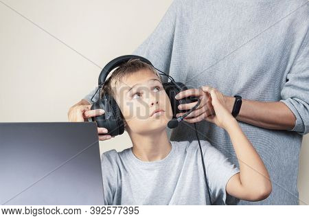 Mother Takes Off Headphones Her Teenage Son. Technology, Gaming, Learning At Home