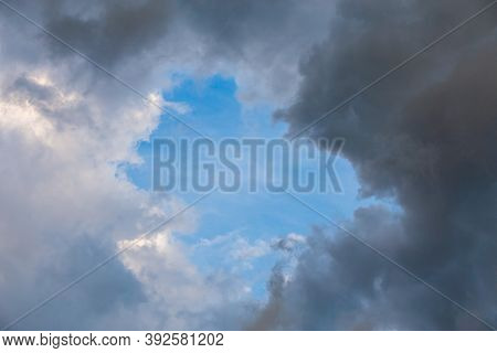 Natural Blue Sky Window In Clouds, Round Gap In Solid Summer Clouds
