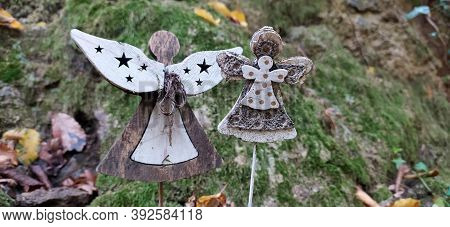 Beautiful Angel Decorations With Wings On Back In Vintage Garden. Angel Statue Against Green Mossy S