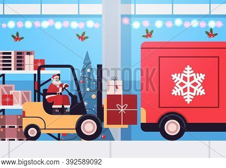 Santa Claus In Mask Forklift Truck Loading Colorful Gifts In Lorry Truck Merry Christmas Happy New Y