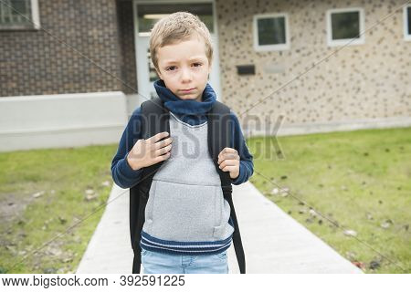 Sad Caucasian Six Years Old Child With A Pensive Look. Sad Elementary School Age Kid Concept Image.