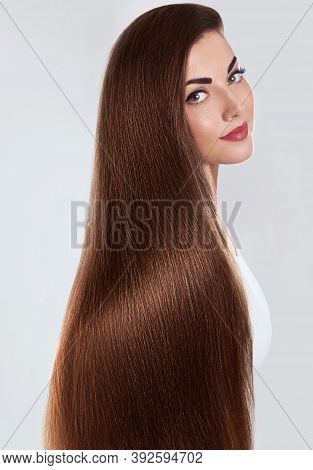Hair.beautiful Woman With Luxurious Long Hair. Gorgeous Model Girl With Healthy Brown Smooth Shiny S