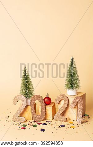 New Year Creative Concept. New Year 2021 Golden Numbers And Two Artificial Christmas Trees, Red Chri
