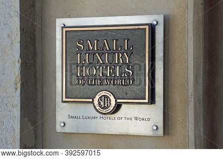 Faro, Portugal - December 27, 2019: Small Luxury Hotels Of The World Wall Advertisement Sign.