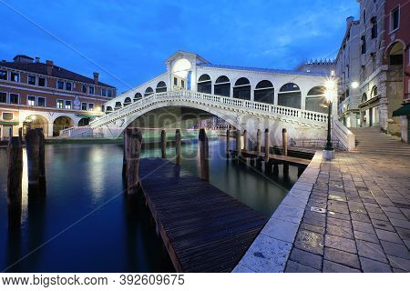 Rialto Bridge On The Grand Canal In Venice, Italy Early In The Morning.