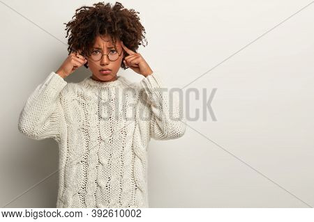 Stressful Female Model Keeps Fingers On Temples, Has Sulking Expression, Looks Distressed, Has Migra