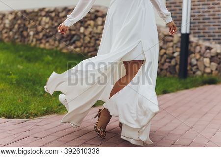 Close-up Of A Bride Dancing In The Street. Body Part. Woman With Bright Dress Dancing In The Street