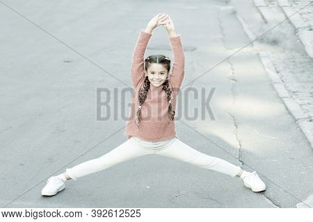 Athletic Is Beautiful. Athletic Child Do Splits. Small Girl Perform Lower Body Athletic Training. Le