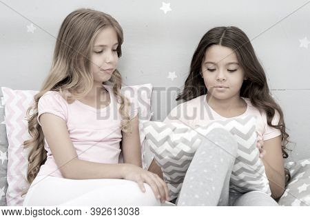 Sisters Communication. Girls In Cute Pajamas Spend Time Together In Bedroom. Sisters Communicate Whi