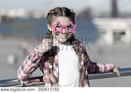 Aint It Funny. Little Girl Looking Through Funny Star Shaped Glasses On Urban Background. Funny Chil