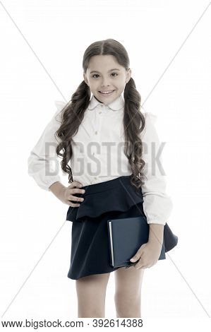 School Textbook And Stationery Concept. Child School Uniform Smart Kid Happy Hold Textbook. Girl Hap