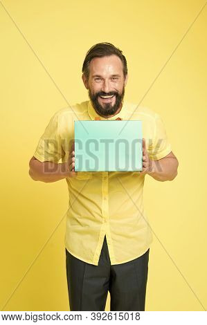 Present Bag. Happy Man Hold Shopping Bag Yellow Background. Paper Bag For Fashion Sale. Gift Wrap Ba