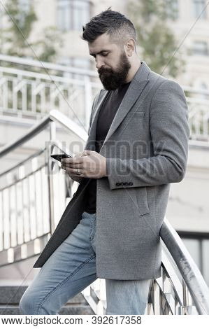 Addicted Concept. Social Networks Dependence. Busy Man Use Mobile Phone Outdoors. Social Media Time