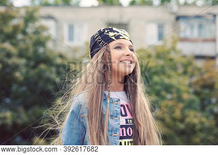 Beautiful And Happy Teen In Park Enjoying The Summer Life Smiling Happily. Hipster Teenager Daydream