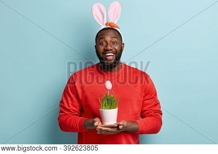 Overweight Afro American Long Haired Man Delivers Decorated Eggs To Well Behaved Children On Easter