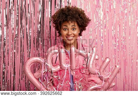 Joyful Young Woman With Make Up Makes Big Party At Night, Dressed In Fashionable Pink Jacket, Holds