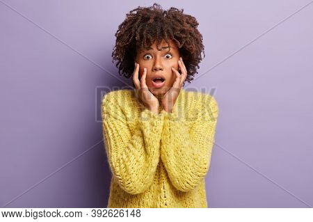 Oh No. Surprised Frightened Dark Skinned Girl Opens Mouth And Eyes From Shock, Reacts On Sudden Terr