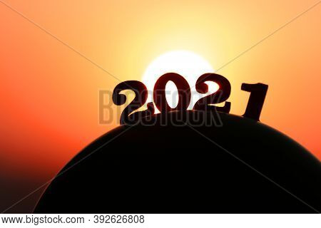 New Year 2021. The Word 2021 Behind The Mountain At Golden Sunset And Beautiful Sky. Concept For Vis