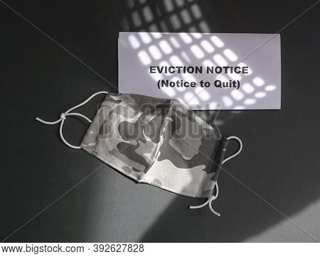 Eviction Notice With Face Mask. Top View.