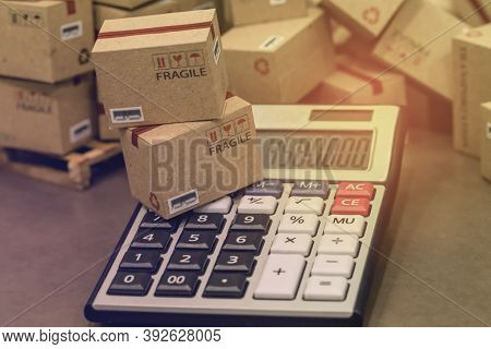 Transportation Business Concept : Small Papers Boxes And Calculator. Idea Of Marketing Planning And
