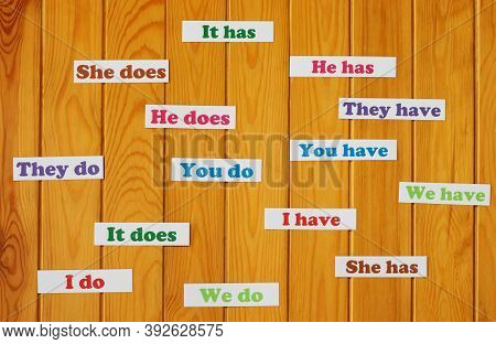 Colorful English Grammar Cards On Wooden Board