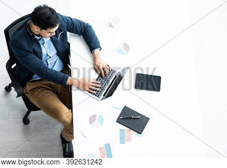 Successful Of Asian Young Businessman Working With Hand Typing Keyboard On Laptop Computer, Tablet W