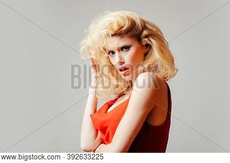 Young Woman Dressed In Pin-up Style. Crazy Furious Young Pin Up Woman Standing Over White Background