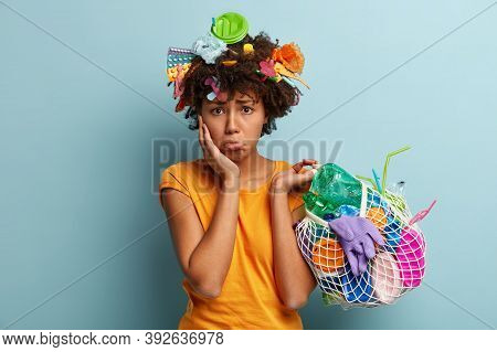 Environmental Problems Concept. Dissatisfied Dark Skinned Woman With Displeased Dejected Expresses,