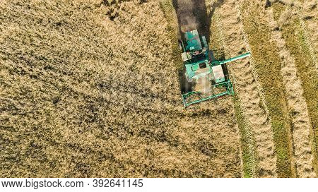 Harvester Machine Working In Field Aerial View From Above, Combine Harvester Agriculture Machine Har