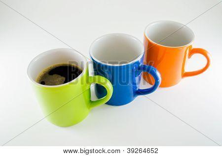 Three diagonal mugs with coffee mug in the center
